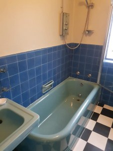 blue art deco free standing bathtub after re enamelling
