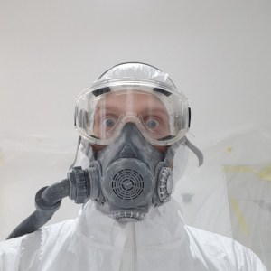 person in a respirator spray mask