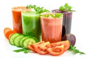 glass full of fruit and vege juices